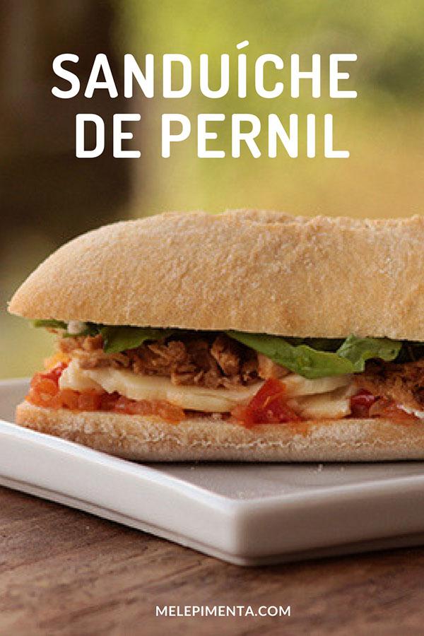 Sanduíche de pernil - Um clássico para você preparar em casa, confira a receita desse sanduíche delicioso feito com carne suína. Ele é montado com pão, carne desfiada, molho, queijo, alface e mais alguns ingredientes. Veja a receita completa.